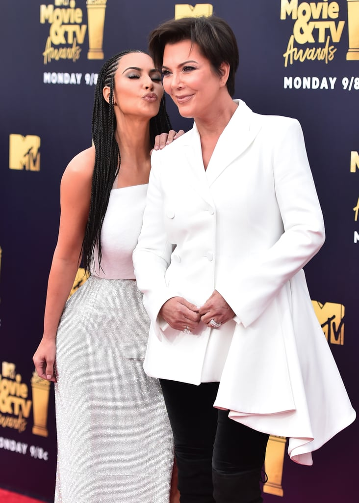"Kim Kardashian hit the red carpet with her mom, Kris Jenner, at the MTV Movie and TV Awards in NYC on Saturday. The mother-daughter duo stuck to a black-and-white color palette for their looks and stayed close while posing for photos together. Kim chose to wear her hair in cornrows for the event, which served as a painful reminder of her Bo Derek-inspired photo shoot back in February. The reality TV star and mother of three has come under fire for wearing culturally appropriated looks, but as she told Instagram commenters earlier this year, she gives ""zero f*cks."" Kim recently made headlines for helping to free great-grandmother Alice Marie Johnson from jail by urging Donald Trump to grant her clemency on her life sentence. The two women met for the first time in an interview for Today last week, and Kim revealed her plans to continue fighting for prison reform."