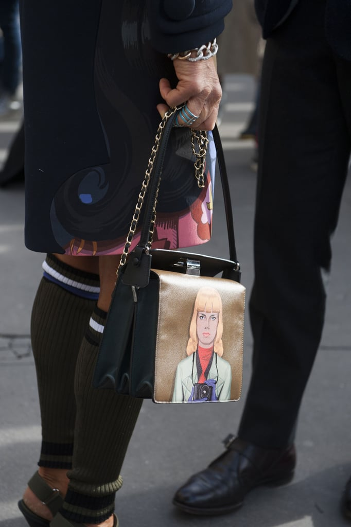 This Prada bag is totally making faces at us.