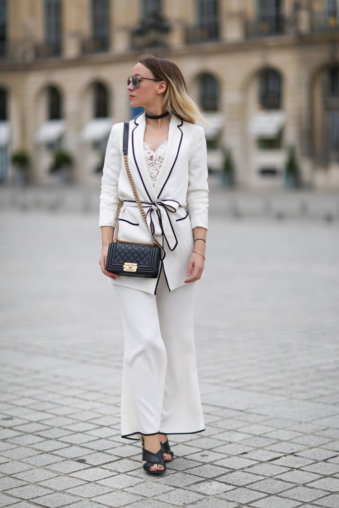 A white pyjama suit with contrast piping