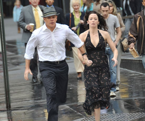 Slide Photo of Matt Damon and Emily Blunt Running On Set In NYC