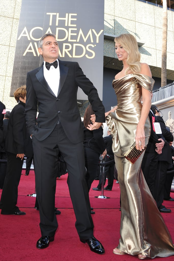 George Clooney and Stacy Keibler make their way down the 2012 Oscar red carpet.