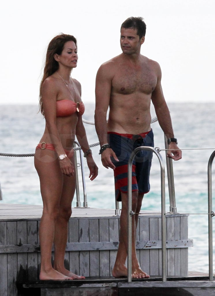 Shirtless David Charvet and bikini-clad Brooke Burke on a pier.