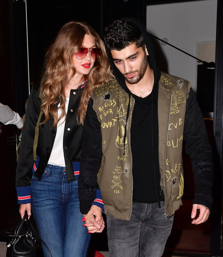 After Gigi Hadid's first Vogue cover hit newsstands on Thursday, the supermodel was spotted looking more in love than ever with boyfriend Zayn Malik when they were spotted out and about in NYC. Gigi paired her gorgeous waves and bright red lips with a plain white t-shirt and jeans, while Zayn tried (and failed) to go incognito in a sweatshirt with the hood pulled up. Although the lovebirds hit a rough patch when they briefly split in June, they've more than made up for lost time with plenty of supercute, PDA-filled public appearances together over the last few weeks. See more photos from their latest outing below!