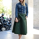 Top a ladylike skirt with a jean jacket.