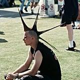 A fan took a quick break on the grass in 1994.