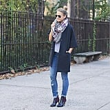A Patterned Scarf, a Short-Sleeved Wool Coat, Ripped Jeans, and Booties