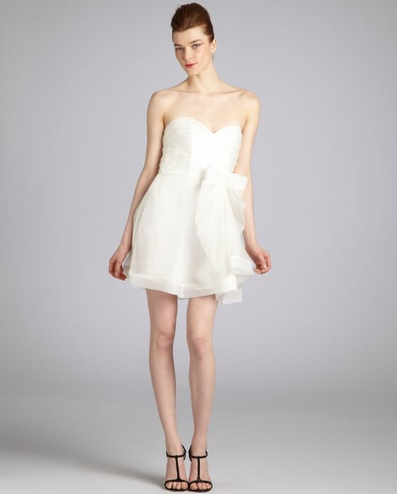 We love the flirty hemline and bow detail on this girlie frock.  A.B.S. by Allen Schwartz Pleated Silk Organza Bow Detail Strapless Dress ($205)