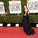 Debra Messing's black gown trailed along the Golden Globe red carpet Sunday night.