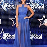 A dramatic blue chiffon gown by Genny was Rochelle's choice at the Global Awards.