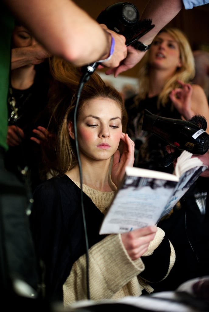 During London's Fashion Week in February, a model read The Man Who Broke Into Auschwitz by Denis Avey while being styled.