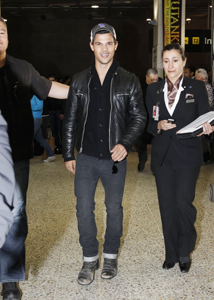 Taylor Lautner was decked out in leather as he made his way through the airport in Melbourne yesterday. He's in Australia to promote Abduction and Taylor hit the red carpet for the movie just hours after landing. Taylor greeted fans and posed for pictures at a special screening, which was held at the Jam Factory, and he'll do the same at another event for the film in Sydney on Tuesday. Abduction comes out in the US next month, though it's another of Taylor's big screen projects that currently has him in the spotlight. New stills from Breaking Dawn were released last week, showing Taylor in a serious scene with costar Nikki Reed.