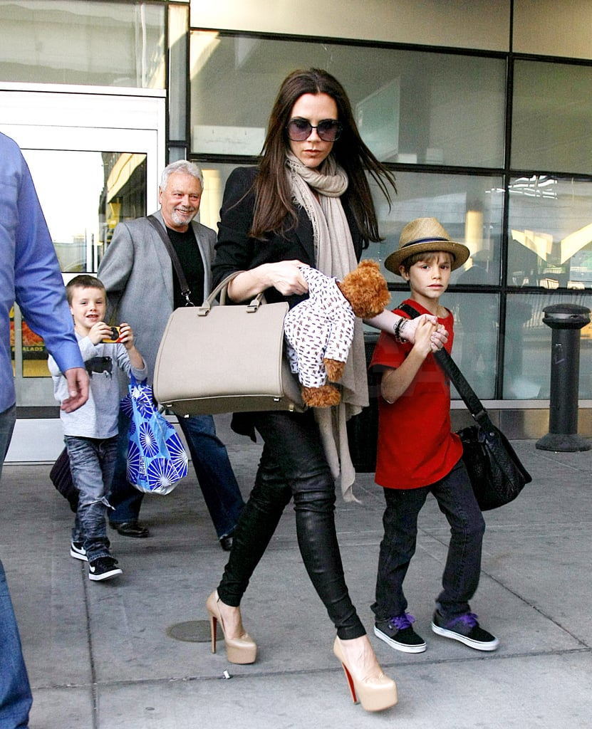 Victoria Beckham held onto her son Romeo's hand with Cruz following right behind as they arrived back at LAX yesterday. The crew also made a stopover in NYC on their way home from London, where David and Victoria Beckham attended the royal wedding on Friday. The hot couple made a grand entrance with his dapper top hat and her dangerously high heels and baby bump. It was an event to remember, and the Beckhams brought their three boys along to witness the festivities in the UK. David returned stateside sooner, joining the LA Galaxy in Dallas for a game yesterday. His team lost, though David insisted that his hectic travel schedule had no effect on his playing. Despite the tough defeat, the celebrations will continue, since today is David's 36th birthday!