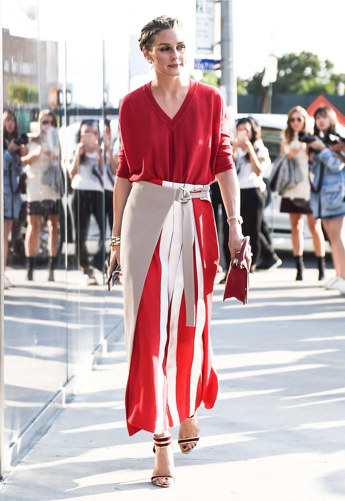 For the DVF show, Olivia stuck to a bright color story, adding interest to a red knit with a colorblocked, pleated skirt.