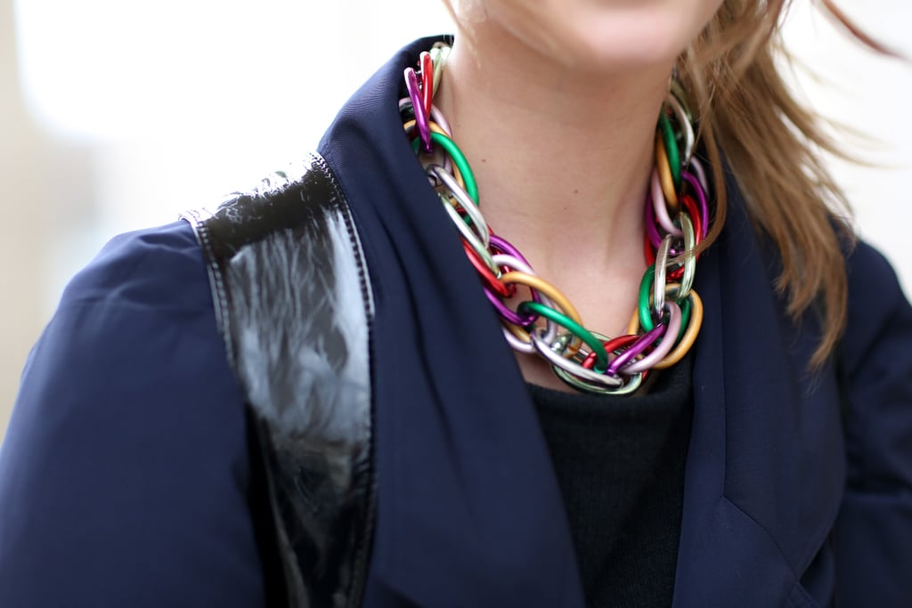 An artsy rainbow-colored chain-link necklace lit up a navy and black ensemble.
