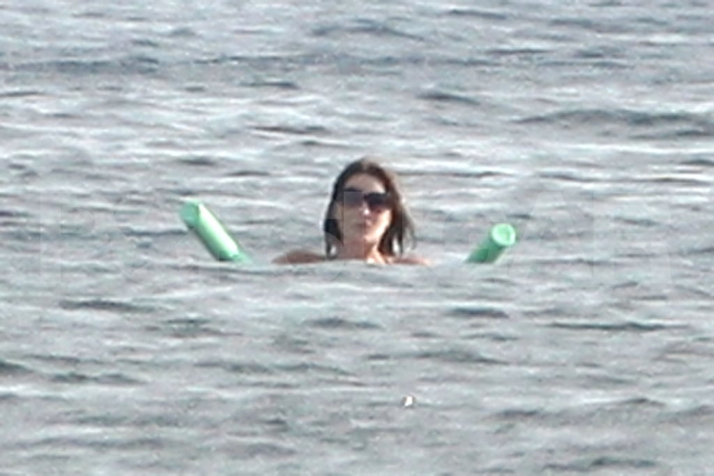 Carla Bruni-Sarkozy floats in the Mediterranean.