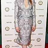 Jessica Chastain opted for a metallic two-piece ensemble and a sleek ponytail.