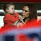 Victoria and Harper shared a cute moment while watching David's Paris Saint-Germain FC match in May 2013.