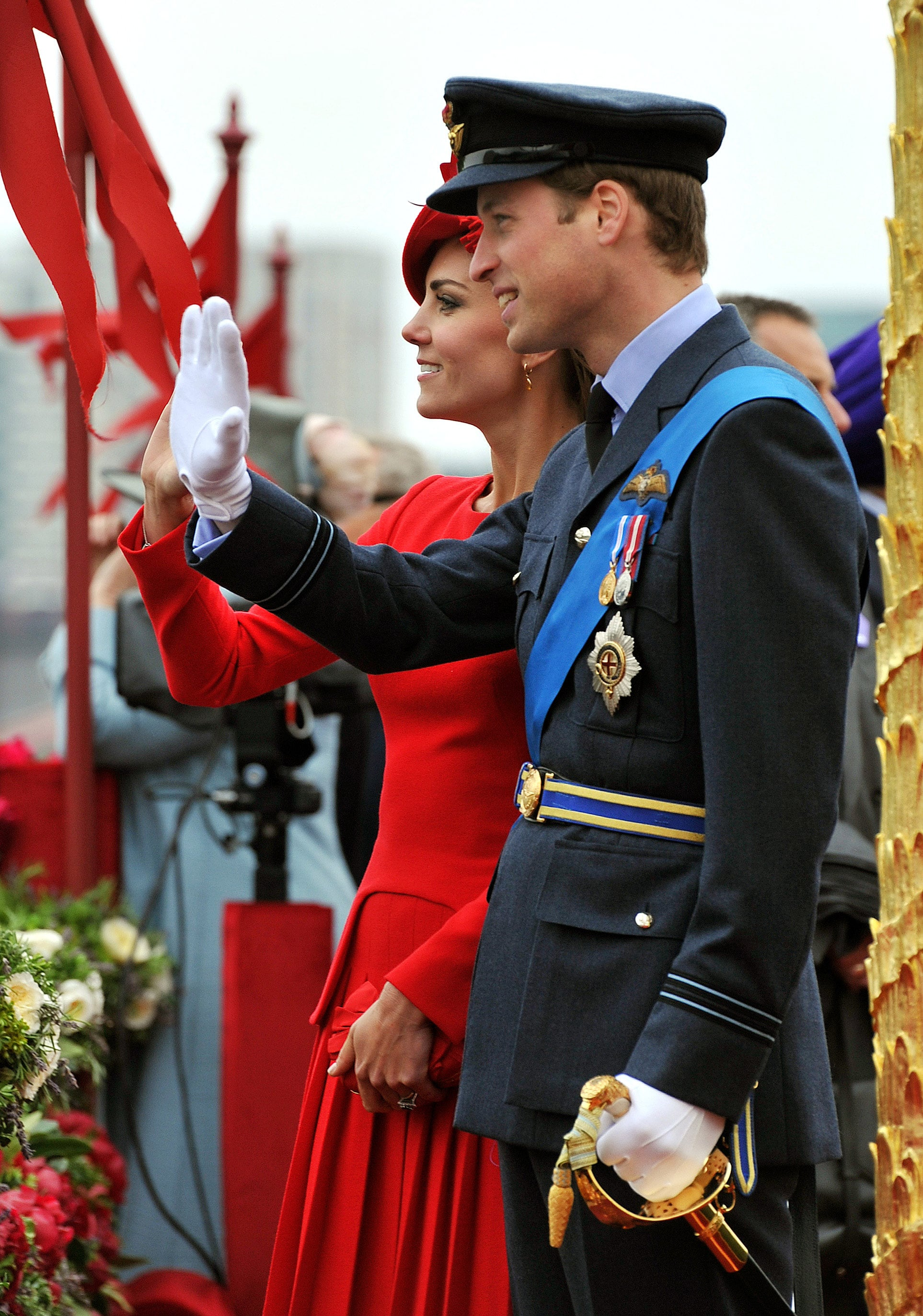 Prince William and Kate Middleton waved in sync during the June 2012 Diamond Jubilee celebrations in London.