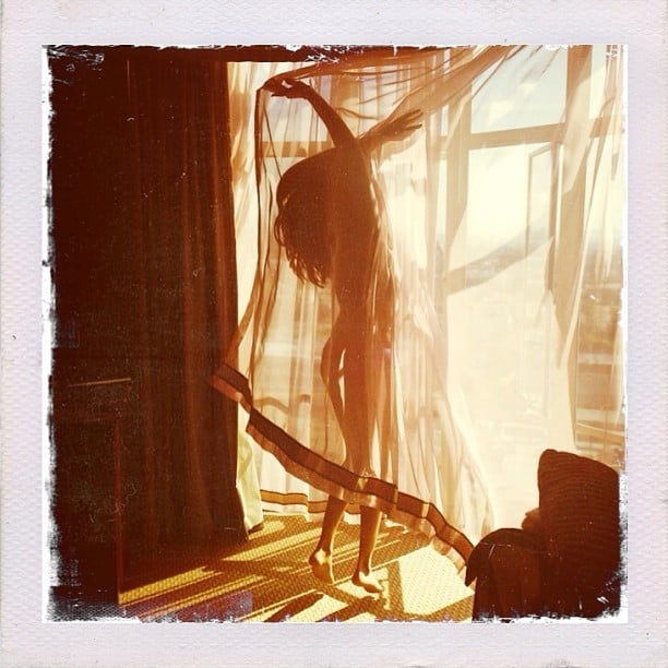 Selena Gomez played around with a sheer curtain and not much clothing. Source: Instagram user selenagomez
