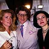 A sweet snap of YSL with two of his favorite people in 1987.