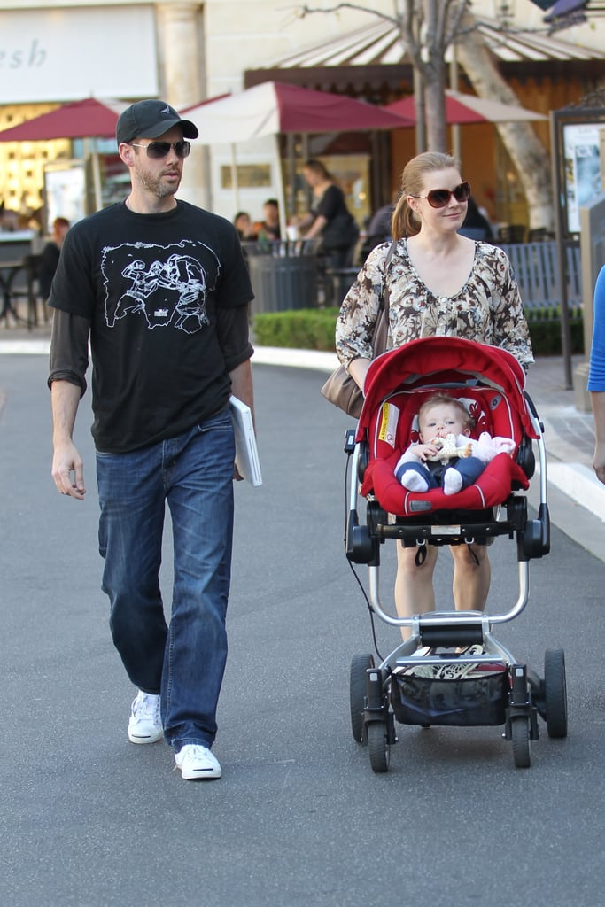 Amy Adams and her fiancé Darren Le Gallo took their daughter Aviana on a shopping trip at The Grove in LA today. The Oscar contender went casual in sandals and sunglasses after getting glammed up for the Academy Awards Nominees Luncheon on Monday, where she sang the praises of her The Fighter costar, Christian Bale. Amy has been busy on the awards-season circuit and shooting The Muppets movie in recent months, but has been soaking up the California sunshine with her young family during her free time. Amy and her castmate Melissa Leo are both up for the best supporting actress little gold man during the Feb 27 show, so who do you think is going to win? Fill out your ballot for a chance to win a Samsung TV!