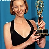 Lisa Kudrow posed proudly with her outstanding supporting actress Emmy award in 1998.