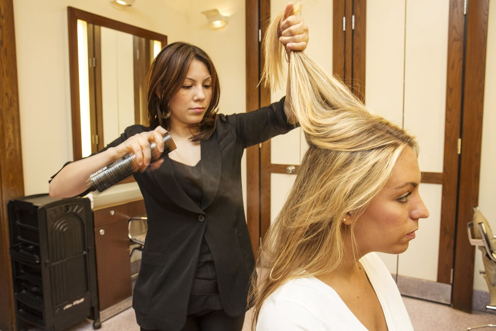 If you're starting off on straight hair (or just want the perfect beach waves), apply a flexible-hold hair spray to your layers before running a curling iron through your hair. This step helps your hair not only hold the style, but also helps with frizz.