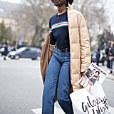 A Navy Jumper, Flared Jeans, and Beige Puffer Coat