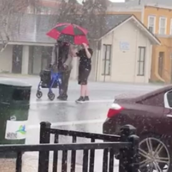Boy Helping a Stranger Cross the Street During a Hail Storm