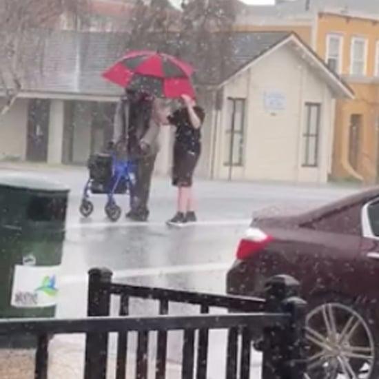 Boy Helping a Stranger Cross the Street During a Hail Storm