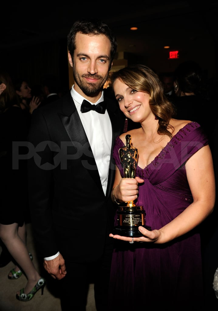 Natalie Portman and Benjamin Millepied cuddled up at the Feb. 2011 Vanity Fair party.