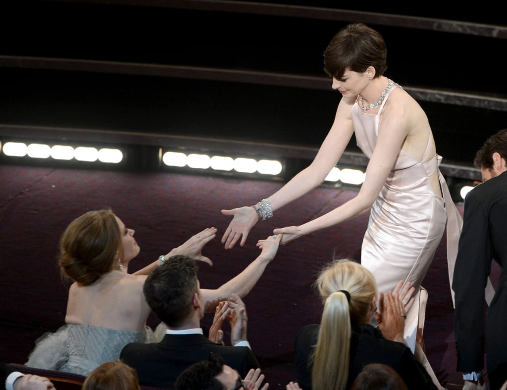 Anne Hathaway with Amy Adams at the Oscars 2013.