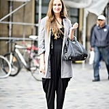 A jumpsuit makes the transition seamlessly with a 'laxed coat to cover up.  Source: Adam Katz Sinding