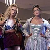 Ivy dons a bikini top decorated with spiders, while Annie opts for a more modest princess period costume.  Photos courtesy of CW