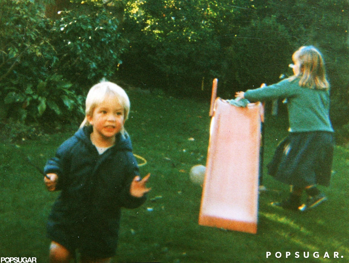 Rob played on a slide with one of his sisters.