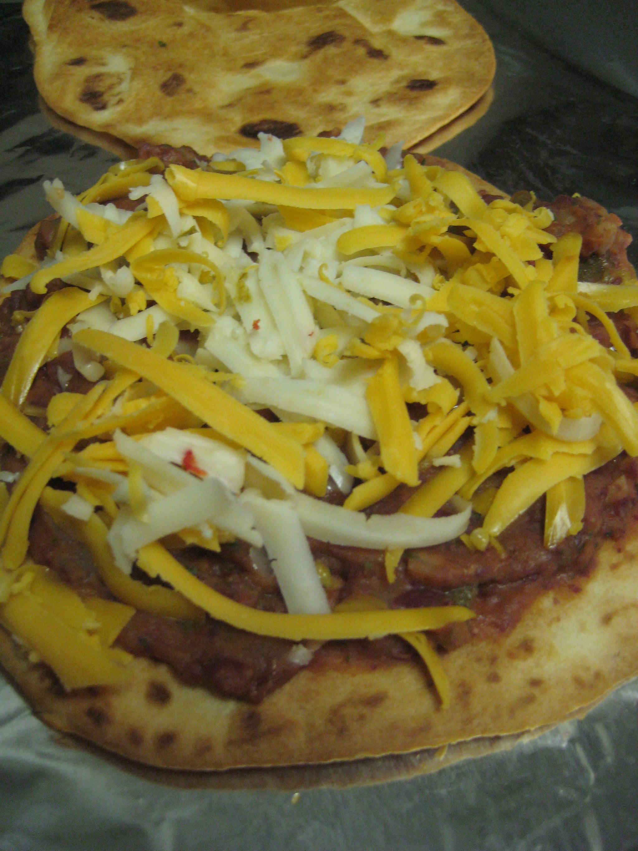 Layer tortilla, sauce, cheese.