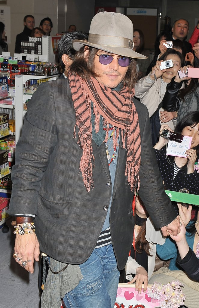 Johnny Depp was greeted by lots of fans as he arrived at Narita Airport today. The actor has been promoting Rango with Isla Fisher, but since their LA premiere the costars have taken the divide and conquer approach. Isla attended premieres in London and Berlin, while Johnny supported Vanessa Paradis at her NYC show.