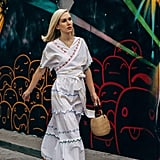 Sometimes a caftan wrap dress looks best accessorized with vacation essentials like a woven bag and natural flats.