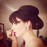 Zooey Deschanel had her makeup touched up before making her way down the red carpet.  Source: Instagram user mararoszak
