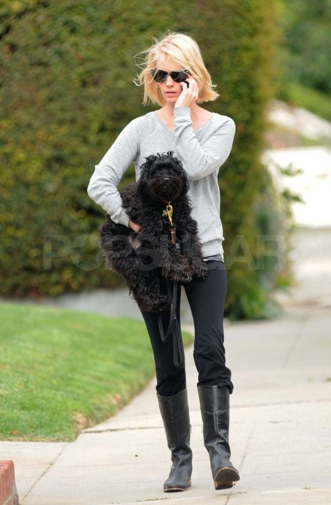 January Jones gave her dog a lift after taking him for a walk around her Los Feliz neighborhood yesterday. She's been lying low in LA taking care of her pup and her fitness with yoga classes while she gears up for the Summer release of X-Men: First Class. January just kicked off press for the project with a spread in Marie Claire UK that was accompanied by a candid interview with controversial quotes about beauty. January was only slightly more covered up for the magazine than she is for her character in the movie, which hits theaters in June. Her fans will have to wait even longer to see her back on the small screen though, since  Mad Men will return in 2012.