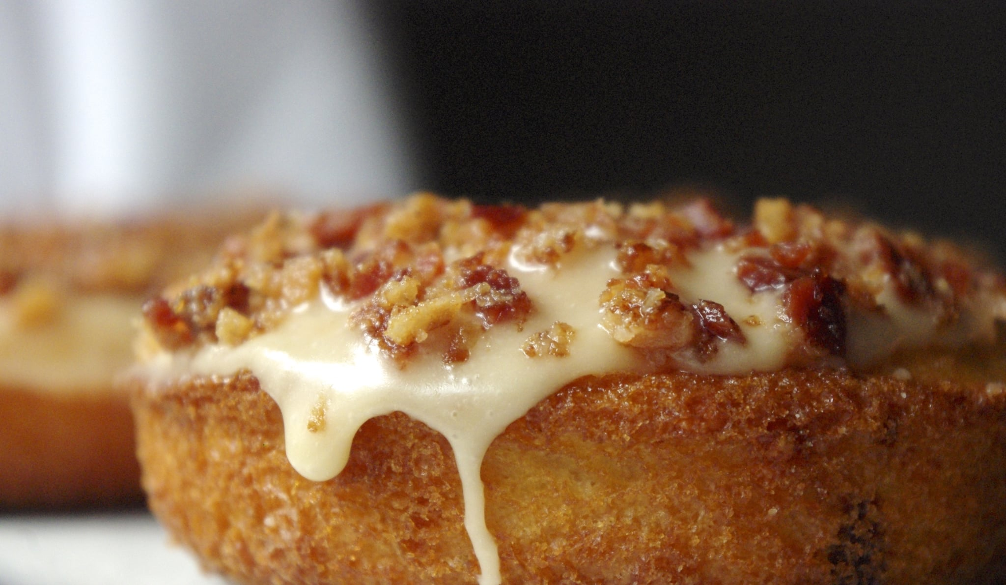 Cheddar Onion Doughnut with Maple Glaze and Bacon