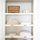 Place labels on your linen cabinet shelves to help you easily identify pillowcases from sheets or to organize sheet sizes.