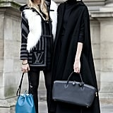 This duo brought two different takes to the show — a touch of fur and a bright bag at left, and the right was all about chic outerwear.