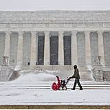 The walkways outside the Lincoln Memorial were cleared of snow by a US Park Service employee.
