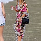 While on vacation in St. Barts, Jessica Alba showed off her resort chic in this Tory Burch floral caftan ($375) and a Tory Burch fedora.