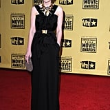Carey waltzed into the Critics' Choice Awards looking downright dapper in a black halter gown, nipped at the waist with a gold hardware belt, and lust-worthy statement necklace.
