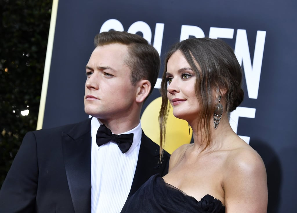 """As the one-and-only Elton John in the biopic Rocketman, Taron Egerton nabbed the best actor award in the motion picture musical or comedy category during the 2020 Golden Globes ceremony.  Playing one of the greatest romantic singers of our time, he's also a romantic himself, bringing his long-time girlfriend Emily Thomas as his companion to the star-studded event.  Like Egerton, Thomas is a Hollywood badass, working as an assistant director in some of our favourite blockbusters in recent years. Here's what you need to know about their relationship and Thomas' behind-the-scenes work in the entertainment industry.  Egerton and Thomas have been dating for a while despite a brief breakup in Nov. 2018, at which point they had been together for two years. In Vogue's April 2019 issue, Egerton said that he and his girlfriend had split up but recently rekindled their romance. As they were both devoted to their work, spending time together was hard. """"Unless you're really vigilant, you can start to occupy separate worlds,"""" he told Vogue. Reigniting their relationship is something that makes the actor """"really proud.""""  And get ready to cue all your feelings: When they were separated, Egerton confessed that he found a card Thomas wrote him so touching that it made him cry.   According to her IMDb page, Thomas is a seasoned assistant director in the film industry, working as a third assistant director in movies such as 7 Days in Entebbe, Solo: A Star Wars Story, The Kid Who Would Be King, and the upcoming Bond flick No Time to Die. She was also Gal Gadot's assistant in Justice League and Wonder Woman in addition to being an uncredited production assistant in Captain America: The Winter Soldier. We're excited to see the Hollywood power couple thriving — maybe there will be a collaboration in the future yet!"""