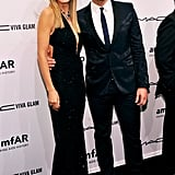 Heidi Klum, wearing Fall 2012 Michael Kors, and Cheyenne Jackson smiled for photographers at the amfAR gala in NYC.