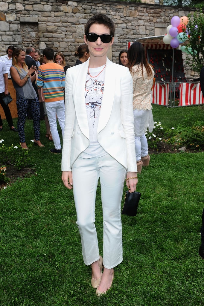 Anne Hathaway posed at the Stella McCartney presentation in NYC.