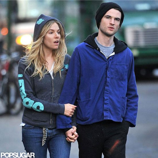 Sienna Miller wore jeans and a hooded sweater while out in NYC with Tom Sturridge.